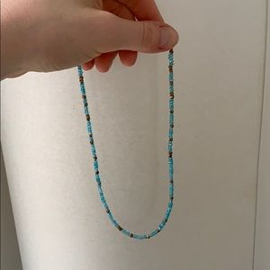 Blue stone and gold bead necklace